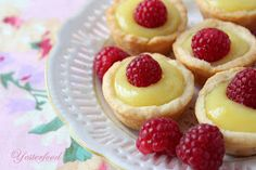 Little bites of luscious, sweet-tart lemon curd in cream cheese crusts, topped with red ripe raspberries