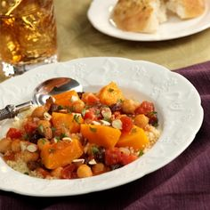 Chunky Butternut 'Stew' with Couscous: A hearty, colorful blend of butternut squash, tomatoes, garbanzo beans and plump raisins simmered in an aromatic broth served over nutty couscous
