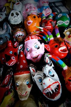 Traditional paper-mache masks diplayed in a market stand in Pátzcuaro, Michoacán, México.