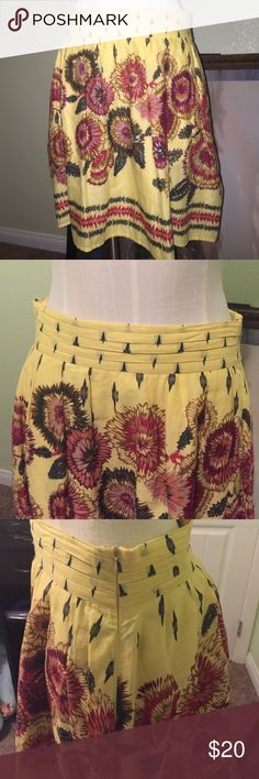 "Emmelee floral skirt Knee length skirt with flowers in reds, green, purples, and pinks on a sunshine yellow background. Lined. Side zip with hidden side pockets. Very light and comfy. 100% cotton. 14"" waist and 20"" long. LIKE ANTHROPOLOGIE BUT NOT. Anthropologie Skirts"