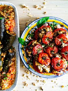 These Israeli stuffed vegetables are so delicious: the tomatoes are filled with a sweet-and-sour mix of rice, walnuts, raisins and herbs while the courgettes have (vegan) mince and warming spices surrounded by a yummy tomato sauce!   #vegan #glutenfree #z