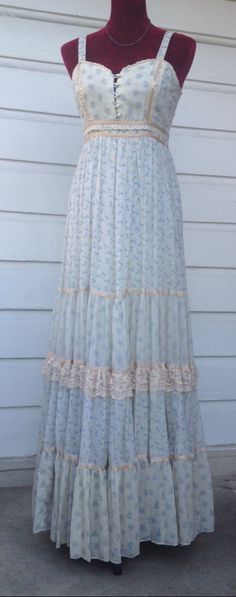 51M83. Pale blue and peach calico Gunne Sax sundress. No tag but I saw a size 7 with a 12.5 in waist and mine is 13 in (so probably a size 9)