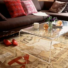Modern style living room with brown sofa with scatter cushions Perspex coffee table and patterned ca