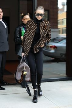 62d2213082a1 Gigi Hadid wearing Fendi Embossed Logo Duffel Bag, Fendi Space Monkey  Multicolor Leather and