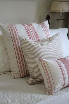 Grain sack & ticking stripe pillows on textured coverlet