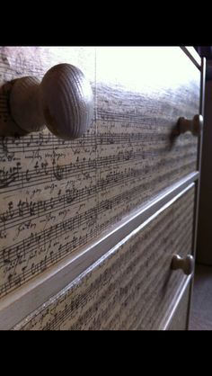 Sheet music dresser. I like this, it shows a lot of personality without being over-the-top. Sophisticated addition to a music themed room.