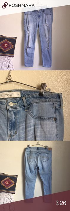 """Abercrombie & Fitch distressed jeans Abercrombie & Fitch distressed jeans. Skinny fit. Signature engraved A&F buttons. Light wash. Size 30 or US 10. """"Regular"""" length. In great condition. Abercrombie & Fitch Jeans Skinny"""