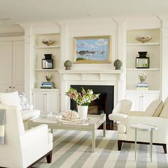 A white fireplace can add a timeless and gorgeous touch to any room. See how these white fireplaces both warm and brighten a room, while emphasizing the shape and design of the hearth.