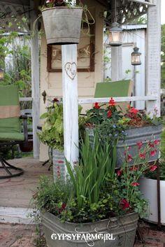 back porch ideas~ love the galvanized pots