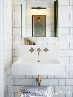 Photo Gallery: Mandy Milks's Bathroom Makeover | House & Home, brass fixtures on the sink, white square cut tile on walls, dark contrasting grout, turkish striped towels, small bathroom, small spaces