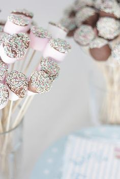 ♥ this idea. Looks like large marshmallow dipped into chocolate and sprinkles with a wooden skewer stick.