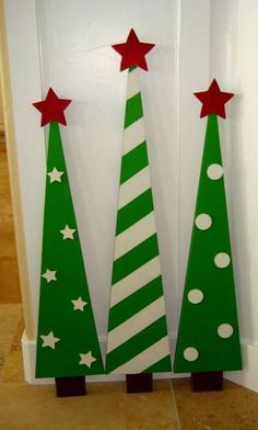 Christmas trees @JoAnn Thoma Murphy what if we have dad build something like this for outside next year and poke holes through it to stick lights and I will paint them