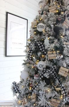 A Cozy, Snow-Flocked Farmhouse Christmas Tree — The Rustic Boxwood