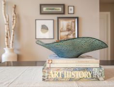 To create a more substantial centerpiece, we stacked a few books under a large decorative bowl.  We made sure to choose books that had colours that would complement the rest of the decor.