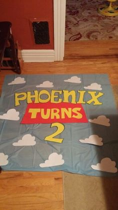 Banner for toy story birthday made with a table cloth and poster board from the dollar tree