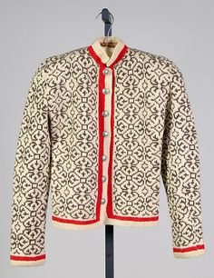 Sweater, designed by Elsa Schiaparelli, ca. 1935, wool w/ metal buttons. Pinned from metmuseum.org