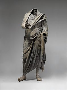 Bronze statue of a man.  ( Hellenistic)