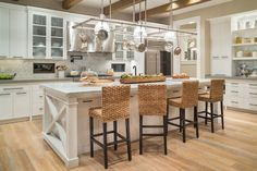 The kitchen would satisfy the cravings of any chef! From the high wood ceilings where you hang your cook-top and island with plenty of workspace. Cabinetry abounds. Check out  24 additional photographs of House Plan 5202. http://houseplans.bhg.com/plan_details.asp?plannum=5202