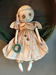 """Village Primitives   ANGELIQUE, Snow Angel.....This is Angelique, and she is 19"""" tall and she has been painted and stained for an aged and vintage look. She's wearing a beige/dusty rose colored, polka dot dress with a silk collar and bloomers. $149.00"""