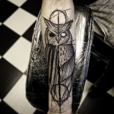 Split design owl tattoo by Damo