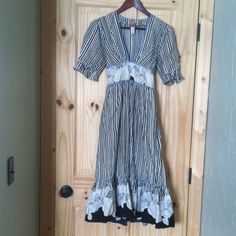 "Beautiful  ""Down East Basics Dress"" This is a great dress! Different and fun! Size M 100% cotton. Blk and Cream striped with flower detail at waist and hem and back. Blue zig zag ribbon trim at seams, Sash tie back.Plunge neckline. Super cute! Down East Dresses Maxi"