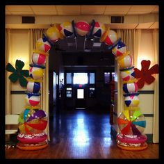 Beach party/luau decorations; arch using beach balls & rings; held together with packing tape and fishing line
