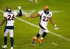 Denver Broncos' Darian Stewart (26) and C.J. Anderson (22), celebrate on the field after defeating the Carolina Panthers, 24-10, in Super Bowl 50 at Levi's Stadium in Santa Clara, Calif., on Sunday, Feb. 7, 2016. (Gary Reyes/Bay Area News Group)