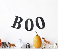 Unique Halloween decor...put masks on toy animals to make them spoooky
