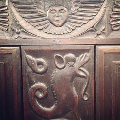 ...this gorgeous wood carving on this cabinet is so dramatic with demonic creatures and guardian angels, that I would expect it to come alive when the clock tolls the midnight hour.... #WHPmakebelieve