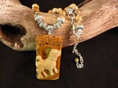 Hand Carved Dog Cut from African Queen Picture by carolesart, $165.00