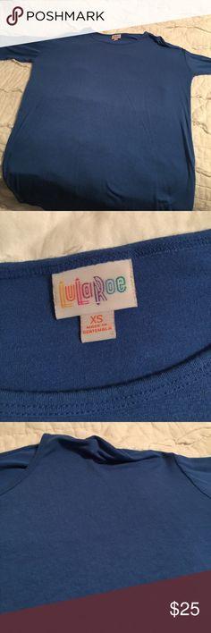 Xs LuLaroe Irma This is a blue xs Irma from LuLaroe. EUC😃 LuLaRoe Tops Tunics