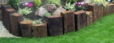 Image result for garden retaining walls using vertical sleepers