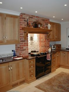 A Quintessential Country Kitchen. Oak Cabinets With A Large Mantel Over The Range  Cooker. Very Welcoming!