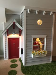 This is the adorable house that my husband built for our kids in our bonus room.   We had a kick out in that room that we were not using so he made a little house.  It is a one bedroom loft with full retro red pottery barn kitchen.  The house is adorable and my husband, well he is amazing.