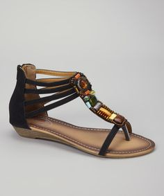 Slip into a fuss-free, casually cool pair of sandals during those laid-back days of relaxation and bliss. A strappy silhouette combines with eye-catching and colorful embellishments to ensure every step is in style.