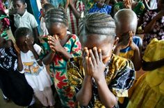 Children pray in Bagbo, Sierra Leone.