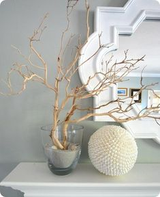 Great DIY decorating blog. Beautiful stuff, like this manzanita branches and shell ball