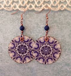 A personal favorite from my Etsy shop https://www.etsy.com/listing/477306058/up-cycled-blue-geometric-print-earrings