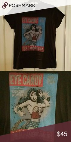 Vintage Torrid Wonder Woman Tee Shirt plus size 1X Offered is an awesome vintage Torrid Wonder Woman graphic Tee Shirt. Made in the USA by Junk food exclusively for Torrid several years back. Graphic is factory distressed. Plus size 1X. New with out tags and in immaculate condition. Eye candy magazine. Junk Food Tops Tees - Short Sleeve