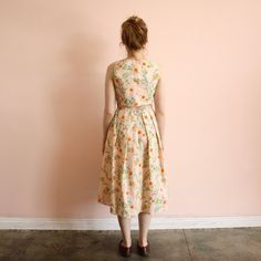 Revive your senses in this exhilarating dress with prints of summer flowers in bloom. Diamond shaped dart design. Cinched waist. Cut out detail and buttons in the back. Pleated skirt. A versatile dress, great for weddings or brunch! 100% cotton.     RACHEL ANTONOFF is designed by Rachel Antonoff in New York and produced in various locales; this item is made in India.