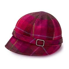 When chill winds blow in from the Irish Sea, stylish town and country women keep themselves warm with beautiful, locally crafted woolens. Look at the world from under the brim of this pink plaid flapper hat, a perfect blend of old and new, made of 100% wool and fully lined. Sizes small, medium and large; dry clean only. Woven and crafted by Mucros Weavers in the Killarney Lakes district of County Kerry, Ireland.
