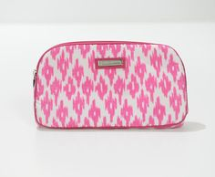 This beautiful deep pink Jim Thompson Thai silk cosmetic bag is guaranteed to delight you!