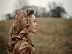tumbling waves 40's style hair. I love this so much. And her makeup.