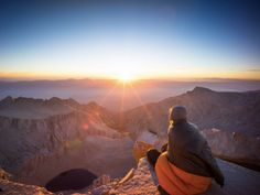 summiting Mt. Whitney just in time to see the sun come up over the valley.