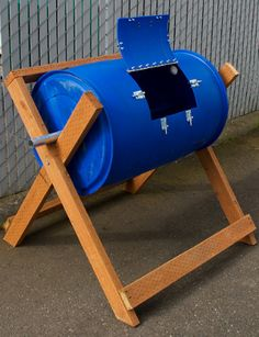 DIY compost tumbler ..the guys at the Extension office made these for a test ..they bought used barrels from a surplus store , just be careful what was in the barrels prior to purchase ...made a support , I think theirs had rollers ... drilled holes for air and a door with a latch then filled them up with a mix of wet ,and dry, and turned away ..a bit more than that but it isn't hard...I think that I will make my door a bit larger than this ...just to make it easier ..and do not add meat…