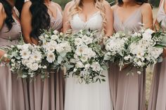 These oversized, wild flower inspired bouquets go beautifully with the #bridesmaidsdresses in dusty lavender. We used white cosmos, snowberries, spray roses and zinnias for this country wedding near #calgary Photo Kadie Hummel #wildflowerbouquets #greenandwhitebouquets #countryweddings #countryweddingdress #cosmos #zinnias #calgaryweddings #calgaryflowers