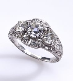 Breathtaking Detail in a Three Diamond Platinum Ring | From a unique collection of vintage engagement rings at https://www.1stdibs.com/jewelry/rings/engagement-rings/