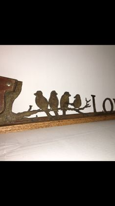 """LOVE"" birds.  Hand cut on a vintage hand saw."