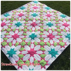 Luminosity quilt. I love everything about this quilt! The Colors, the Pattern, and the Quilting! Gotta give this a try.