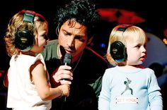 Chris Cornell and his children Toni and Christopher on stage during a concert at the Beacon Theatre on July 31, 2007 in New York City